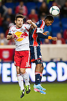 Jerry Bengtson (27) of the New England Revolution goes up for a header with Heath Pearce (3) of the New York Red Bulls. The New York Red Bulls defeated the New England Revolution 4-1 during a Major League Soccer (MLS) match at Red Bull Arena in Harrison, NJ, on March 20, 2013.
