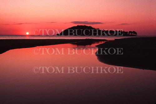 Sunrise at Little Presque Isle near Marquette, Michigan on Lake Superior. Harlow Creek in the foreground.