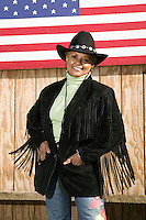 2 December 2006 - New York City, NY - Jean Best, a member of the Federation of Black Cowboys, poses for the photographer at the Cedar Lanes stables in the borough of Queens in New York City, USA, 2 December 2006. The Federation gathers black men and women who recreate the heritage of black cowboys, teach kids to ride and put on 'rodeo showdeos'.