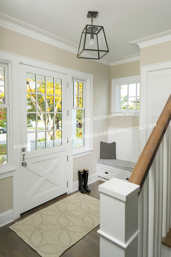 A beautiful dutch door adds an old-fashioned element to the entry of this traditional home. This image is available through an alternate architectural stock image agency, Collinstock located here: http://www.collinstock.com