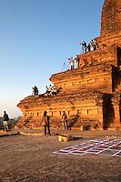 Myanmar, Burma. Bagan.  Photographers on Temple Platforms for Morning Sunrise.