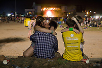 BENIC&Agrave;SSIM, SPAIN - Young Spaniards embrace during a performance by English band Leftfield at the Festival's main stage...Described by some as a Mediterranean Glastonbury, the Festival Internacional de Benic&agrave;ssim (FIB) is the largest music festival outside the UK to target British visitors. In 2010, seven of the eight main headline slots were filled by English bands...A small coastal town of 13,000 inhabitants, Benic&agrave;ssim hosted some 200,000 visitors in 2009, with 40% of those believed to be coming from the UK. In 2010, attendances fell to 127,000 visitors but the percentage of UK visitors is believed to have risen.