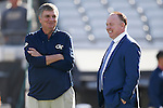 Head coach Mark Stoops of the Kentucky Wildcats talks with head coach Paul Johnson of the Georgia Tech Yellow Jackets prior to the TaxSlayer Bowl at EverBank Field on Saturday, December 31, 2016 in Jacksonville, Florida. Photo by Michael Reaves   Staff.