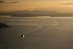 Passenger ferry boat on Elliott Bay coming to terminal Seattle Waterfront  Washington State USA