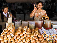 Colonial architecture and food are two of the lasting influences of the previous French colonisation of Laos. Delicious baguettes are a common item for sale in the markets. (Photo by Matt Considine - Images of Asia Collection)