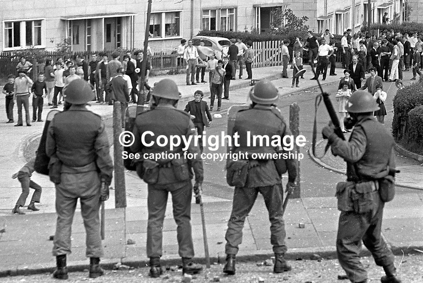 British soldiers confront rioters in Ballymurphy housing estate, West Belfast, N Ireland, UK. 197006270237...Copyright Image from Victor Patterson, 54 Dorchester Park, Belfast, UK, BT9 6RJ..Tel: +44 28 9066 1296.Mob: +44 7802 353836.Voicemail +44 20 8816 7153.Skype: victorpattersonbelfast.Email: victorpatterson@mac.com.Email: victorpatterson@ireland.com (back-up)..IMPORTANT: If you wish to use this image or any other of my images please go to www.victorpatterson.com and click on the Terms & Conditions. Then contact me by email or phone with the reference number(s) of the image(s) concerned.