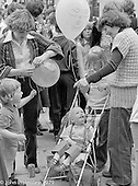 Mums and babes at the Education Centre, Festival & Gala Day, Wester Hailes, Scotland, 1979.  John Walmsley was Photographer in Residence at the Education Centre for three weeks in 1979.  The Education Centre was, at the time, Scotland's largest purpose built community High School open all day every day for all ages from primary to adults.  The town of Wester Hailes, a few miles to the south west of Edinburgh, was built in the early 1970s mostly of blocks of flats and high rises.
