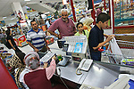 An Iraqi family goes through the checkout line at a large department store in Duhok, Iraq. Although international tourism is almost non-existent, Kurdistan is a major destination for Iraqis seeking to escape the violence that has plagued the country follwing the US invasion in 2003...Stability and security prevail in postwar Iraqi Kurdistan as Iraqi tourists, many of them from Baghdad, flock to the northern cities and their amusement parks and national parks to escape violence and sectarian strife in the central and southern regions of the country.