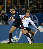 Heather O'Reilly (left) controls the ball ahead Babett Peter. US Women's National Team vs Germany at Impuls Arena in Augsburg, Germany on October 27, 2009.