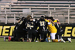 11 December 2009: Wake Forest's starters huddle before the game. The University of Virginia Cavaliers defeated the Wake Forest University Demon Deacons 2-1 after overtime at WakeMed Soccer Stadium in Cary, North Carolina in an NCAA Division I Men's College Cup Semifinal game.