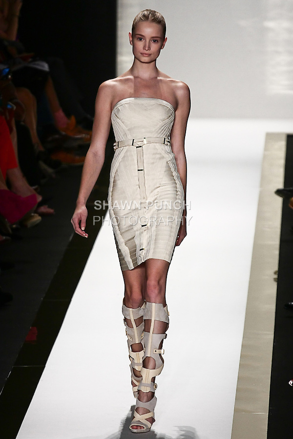 Maud Welzen walks the runway in a corozo bandage strapless dress, with vapor gladiator boot, by Max Azria for the Herve Leger by Max Azria Spring 2012 fashion show, during Mercedes-Benz Fashion Week Spring 2012.