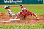 21 March 2015: Washington infielder Kevin Frandsen dives safely into third during the 6th inning of a Spring Training Split Squad game against the Atlanta Braves at Champion Stadium at the ESPN Wide World of Sports Complex in Kissimmee, Florida. The Braves defeated the Nationals 5-2 in Grapefruit League play. Mandatory Credit: Ed Wolfstein Photo *** RAW (NEF) Image File Available ***