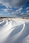 Wind-carved drifts of snow in the dunes of teh High Head area of Cape Cod National Seashore.