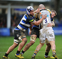 Leroy Houston and Dominic Day of Bath Rugby double-tackle Jake Cooper-Woolley of Wasps. Aviva Premiership match, between Bath Rugby and Wasps on February 20, 2016 at the Recreation Ground in Bath, England. Photo by: Patrick Khachfe / Onside Images