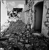 Bent Jbeil, South Lebanon, September 2006.Magida Moghne, 54, in front of her devastated house. Bent Jbeil, called by its inhabitants 'The Liberation Town', was the epicentre of the Lebanese armed resistance during the 18 years of Israeli occupation of South Lebanon. As a probable reprisal, the old town centre has been almost completely levelled down by the Israeli Army during this conflict and is now littered with unexploded ordnance of all kinds.