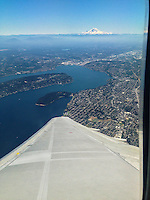 Mt. Rainier sits on the horizon as my plane departs from Seattle-Tacoma International Airport.