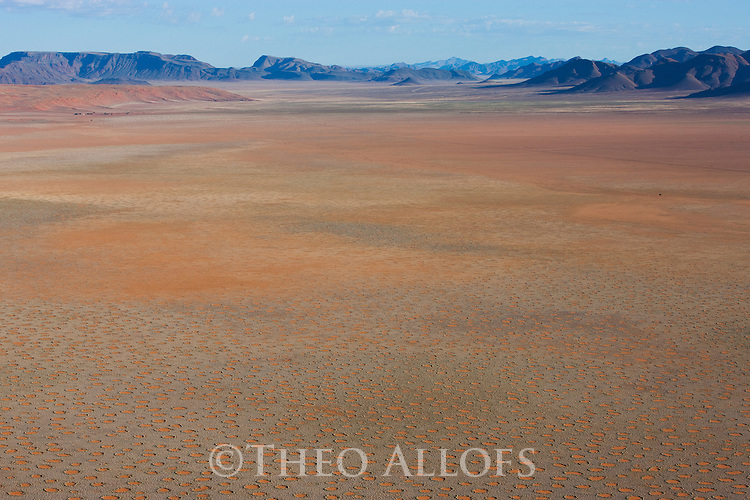 Namibia, Namib Desert, Namibrand Nature Reserve, aerial of vast plain covered with fairy circles