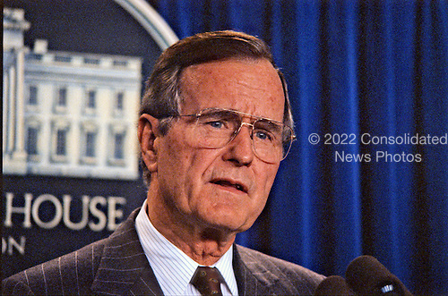 United States President George H.W. Bush holds a press conference in the Brady Briefing Room of the White House in Washington, D.C. to announce additional troops are being sent to Saudi Arabia as part of Operation Desert Shield on October 8, 1990..Credit: Howard L. Sachs / CNP