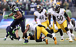 Seattle Seahawks running back Thomas Rawls (34) runs past Pittsburgh Steelers safety Mike Mitchell (23) at CenturyLink Field in Seattle, Washington on November 29, 2015.  The Seahawks beat the Steelers 39-30.      ©2015. Jim Bryant Photo. All Rights Reserved.