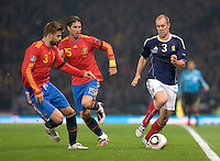 Spain's Gerard Pique (L) and Sergio Ramos vies with Scotland's Steven Whittaker during their Euro 2012 qualifying football match at Hampden Park, Glasgow, Scotland, on October 12 2010.