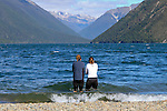 NELSON LAKES, NEW ZEALAND - APRIL 18:  Two athletes cool off in the shallows of Lake Rotoiti after the 2015 Alpine Lodge Loop The Lake trail run at Lake Rotoiti on April 18 16, 2015 in Nelson, New Zealand. (Photo by Marc Palmano/Shuttersport Limited)