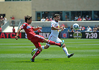 Chicago midfielder Baggio Husidic (9) clears the ball in front of New York defender Carlos Mendes (44).  The Chicago Fire tied the New York Red Bulls 1-1 at Toyota Park in Bridgeview, IL on June 26, 2011.