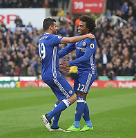 Chelsea's Willian celebrates scoring his sides first goal  with Diego Costa<br /> <br /> Photographer Mick Walker/CameraSport<br /> <br /> The Premier League - Stoke City v Chelsea - Saturday 18th March 2017 - bet365 Stadium - Stoke<br /> <br /> World Copyright &copy; 2017 CameraSport. All rights reserved. 43 Linden Ave. Countesthorpe. Leicester. England. LE8 5PG - Tel: +44 (0) 116 277 4147 - admin@camerasport.com - www.camerasport.com