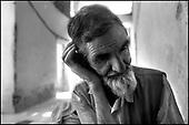 Kabul, August - September 2002 Afghanistan<br /> After 23 years of constant war Afghanistan tries to stand on its feet. There is a feeling of relative peace in the country. Life slowly returns to normal for the civilian population. Music teacher at school which reconstruction is being taken care of by the Polish Humanitarian Organization, Kabul.<br /> (Photo by Filip Cwik / Newsweek Polska / Napo Images)<br /> <br /> PICTURE TAKEN ON NEGATIVES<br /> <br /> <br /> Kabul sierpien - wrzesien 2002 Afganistan.<br /> Po 23 latach nieustajacych wojen Afganistan probuje stanac na nogi. W kraju panuje wzgledny pokoj. Ludnosc cywilna powoli wraca do normalnego zycia. Nauczyciel w szkole muzycznej w Kabulu ktorej odbudowa zajmuje sie Polska Akcja Humanitarna.<br /> (fot. Filip Cwik / Newsweek Polska / Napo Images)