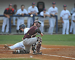 Ole Miss' Matt Snyder (33) scores as the ball bounces off Mississippi State catcher Wes Thigpen (31) at Oxford-University Stadium in Oxford, Miss. on Thursday, May 12, 2011. (AP Photo/Oxford Eagle, Bruce Newman)