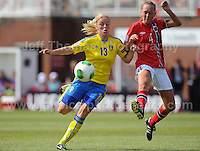 Mimmi Larsson of Sweden battles with Carlotta Fennefoss of Norway during the UEFA Womens U19 Championships at Stebonheath park Sunday 25th August 2013. All images are the copyright of Jeff Thomas Photography-www.jaypics.photoshelter.com-07837 386244-Any use of images must be authorised by the copyright owner.