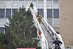 Two firefighters come down a ladder to get more equipment during the Chem-Phys fire September 7.