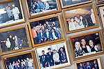 """Photos of clients, including celebrities and politicians, line the walls of the Yasuda family's """"Yakata-bune"""" pleasure boat business in Tokyo, Japan on 31 August  2010. .Photographer: Robert Gilhooly"""