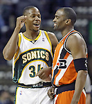 .Seattle SuperSonics Ray Allen jokes (34) with Los Angeles Clippers Cuttion Mobley before tipoff  on Friday, April 14, 2006 at the Key Arena in Seattle.  Jim Bryant Photo. &copy;2010. All Rights Reserved.