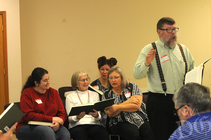 NWA Democrat-Gazette/FLIP PUTTHOFF <br /> Singers, including Brandy Siler (from left) Katy Black, Bonnie Wood and Bonnie Whitbeck, sing Saturday Oct. 24, 2015 at the convention in Springdale.