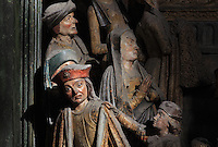 People of Amiens waiting to be baptised by St Firmin, Gothic style polychrome high-relief sculpture from the South side of the choir screen, 1490-1530, commissioned by canon Adrien de Henencourt, depicting the life of St Firmin, at the Basilique Cathedrale Notre-Dame d'Amiens or Cathedral Basilica of Our Lady of Amiens, built 1220-70 in Gothic style, Amiens, Picardy, France. St Firmin, 272-303 AD, was the first bishop of Amiens. Amiens Cathedral was listed as a UNESCO World Heritage Site in 1981. Picture by Manuel Cohen