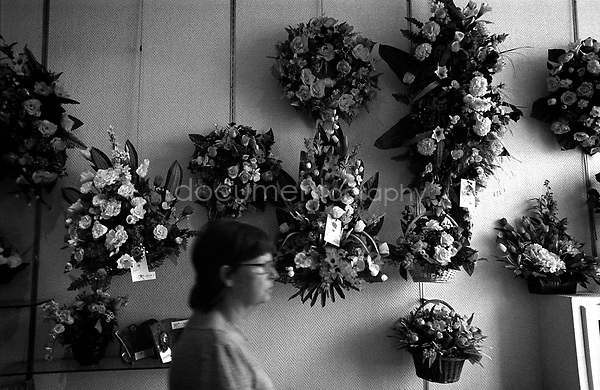 """""""Let's call your sister and get her opinion on how we should arrange the grave. I would like her conscent before we decide on the flowers and so on."""" says my mother to me.....© Magali Corouge/Documentography.2004-2006.France"""