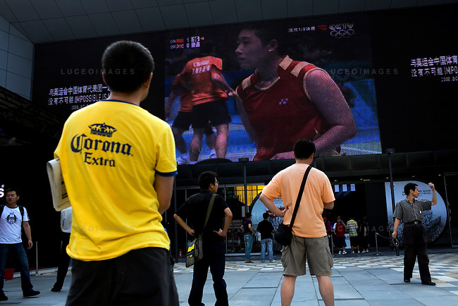 The Adidas store shows live coverage of the Olympic Games in downtown Beijing, China on Tuesday, August 12, 2008.  Kevin German