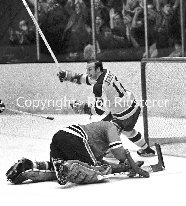 Seals Gary Jarrett  and Blackhawks goalie Gerry Desjardins. Chicago. (1970 photo by Ron Riesterer)