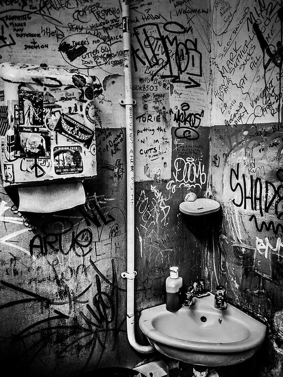 Toilet with graffiti