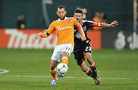Houston Dynamo midfielder Brad Davis (11) goes against D.C. United midfielder Perry Kitchen (23) D.C. United tied The Houston Dynamo 1-1 but lost in the overall score 4-2 in the second leg of the Eastern Conference Championship at RFK Stadium, Sunday November 18, 2012.