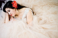 Samantha Contreras lays in her dress before the Cinco de Mayo Pageant on May 6, 2016 in South Omaha, Neb.