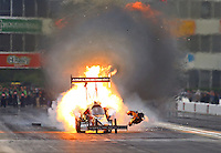 May 1, 2016; Baytown, TX, USA; NHRA top fuel driver Terry McMillen explodes an engine on fire during the Spring Nationals at Royal Purple Raceway. Mandatory Credit: Mark J. Rebilas-USA TODAY Sports