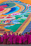 Monks in front of a thangka for the Tibetan New Year, Labrang Monastery, Gansu Province, China