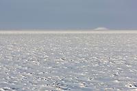 Pingo on the snow covered arctic coastal plain, Alaska.