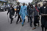 "KINSHASA, DEMOCRATIC REPUBLIC OF CONGO - FEBRUARY 10: Papa Griffe (in blue suit), a senior and a leader of the Sapeurs walks with some of his men after paying his respect to Stervos Nyarcos, the founder of the kitendi religion, which means clothing in local language Lingala. Nyarcos was known as the leader of the Sape movement, at Gombe cemetery on February 10, 2012 in Kinshasa, DRC. The word Sapeur comes from SAPE, a French acronym for Société des Ambianceurs et Persons Élégants or Society of Revellers and Elegant People and it also means, to dress with elegance and style"". Griffe has been a sapeur most of his life, and owns a few business and a car. He was made a career of being a sapeur. Most of the young Sapeurs are unemployed, poor and live in harsh conditions in Kinshasa,  a city of about 10 million people. For many of them being a Sapeur means they can escape their daily struggles and dress like fashionable Europeans. Many hustle to build up their expensive collections. Most Sapeurs could never afford to visit Paris, and usually relatives send or bring clothes back to Kinshasa. (Photo by Per-Anders Pettersson)"