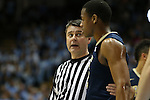 14 February 2016: Referee Pat Driscoll (left) talks with Pittsburgh's Chris Jones (right) during a timeout. The University of North Carolina Tar Heels hosted the University of Pittsburgh Panthers at the Dean E. Smith Center in Chapel Hill, North Carolina in a 2015-16 NCAA Division I Men's Basketball game. UNC won the game 85-64.