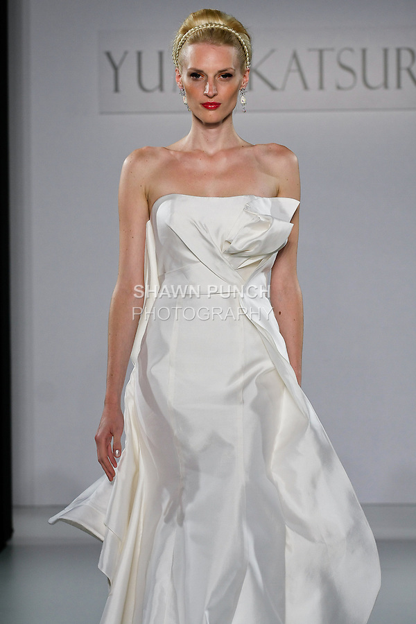 """Model walks runway in a Sendai wedding dress from the Yumi Katsura Fall 2013 """"Painting The World With Beauty"""" bridal collection, during The Couture Show New York Bridal Fashion Week, October 14, 2012."""
