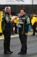 Feb 10, 2017; Pomona, CA, USA; Tommy DeLago (left) crew chief for NHRA funny car driver Alexis DeJoria (not pictured) and Nick Boninfante during qualifying for the Winternationals at Auto Club Raceway at Pomona. Mandatory Credit: Mark J. Rebilas-USA TODAY Sports