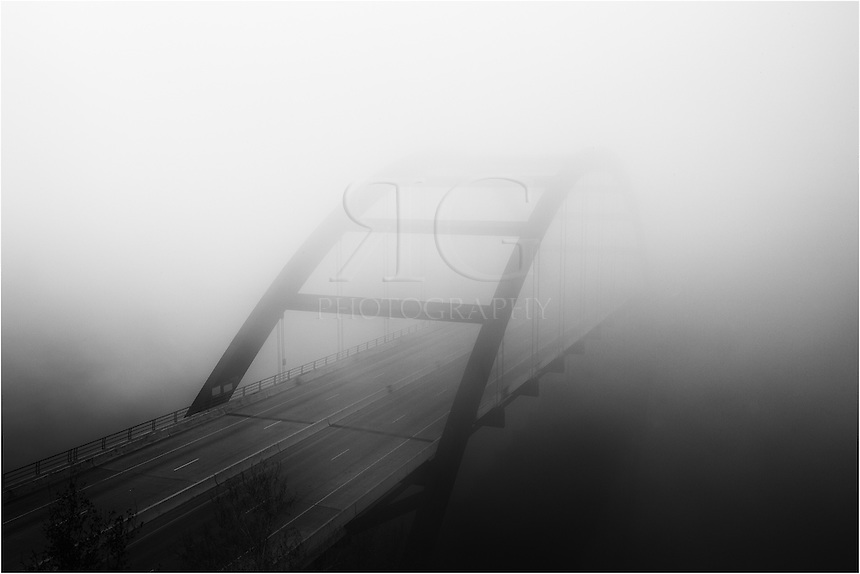 An artistic image of Pennybacker Bridge engulfed in morning fog is offered in this photograph from Austin, Texas.