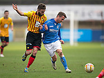 Partick Thistle v St Johnstone.....14.03.15<br /> Chris Millar fends off Steven Lawless<br /> Picture by Graeme Hart.<br /> Copyright Perthshire Picture Agency<br /> Tel: 01738 623350  Mobile: 07990 594431